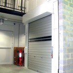 Automatic roller shutter doors with vision panels